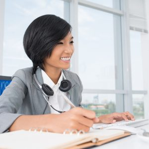 Certificate III in Accounts Administration: woman is working with a headset around her neck