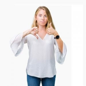 understanding and managing conflict at work: Woman in a white top shows a thumbs up and a thumbs down