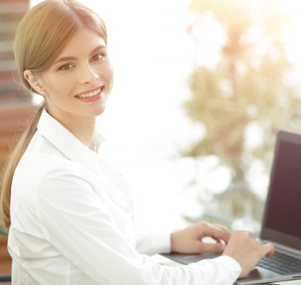 producing documents: girl in white is working on her laptop