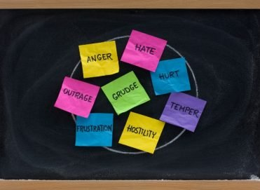 negative emotions: post its on the board